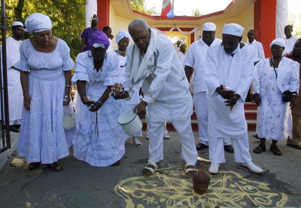 Haitian Voodoo believers take part in a ceremony to commemorate the one-year anniversary of the earthquake in Port-au-Prince