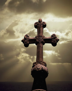 Sunbeams Backlighting Cross --- Image by © Royalty-Free/Corbis